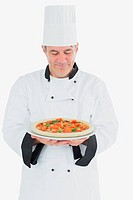 Happy chef holding pizza