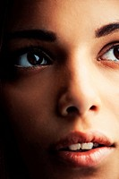Cropped close up of a naturally gorgeous young hispanic woman gazing upward