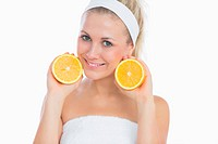 Beautiful woman with sliced orange