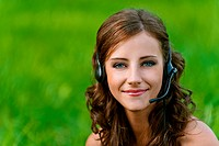 woman close up in headphones and microphone