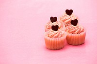 Four valentines cupcakes with chocolate hearts