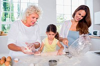 Multi_generation family women baking together