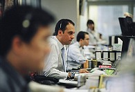 Workers in the office of Credit Suisse First Boston CSFB, a leading stockbroker and investment bank
