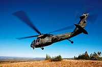 A Sikorsky UH_60 Blackhawk helicopter, configured for medevac operations, lifts of from a landing zone at 10,000 feet above sea level, in Colorado´s R...
