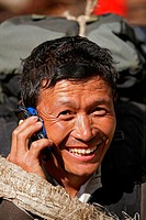 A Nepalese porter talks on his cell phone during a trek to Mount Everest Base Camp.