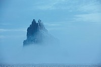 Winter fog shrouds Shiprock, also called Ship Rock, an ancient volcanic plug near Farmington, New Mexico.