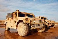 HMMW, or Humvee, parked on a muddy road in Afghanistan´s Helmand Province