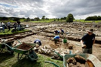 Archaeological excavation Vindolanda under clouded sky, The Roman Vindolanda Fort, World Heritage Site, Bardon Mill, Hexham, Northumberland, England, ...