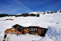 Snow covered alpine hut with Gebra in background, Hochwildalmhuette, Gebra, Kitzbuehel range, Tyrol, Austria, Europe