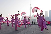 Morning exercises, women doing fan dance at the Bund in the morning, Shanghai, China