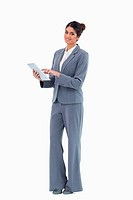 Smiling saleswoman using tablet