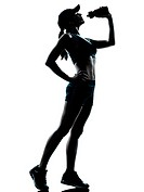 one caucasian woman runner jogger drinking in silhouette studio isolated on white background