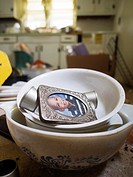 A kid´s school picture in dishes inside a foreclosed home in Haw River, North Carolina, United States