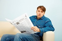 ESY-005226948 Man disappointed with news from newspaper
