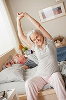Senior woman stretching after waking up