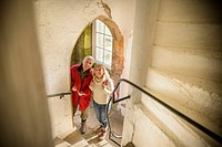 Couple exploring medieval castle