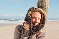Woman wearing scarf on beach
