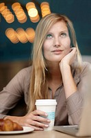 Woman having breakfast in coffee shop