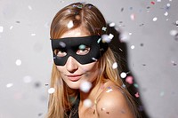 Woman wearing mask in confetti
