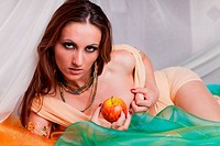 Young beautiful woman with fruit.