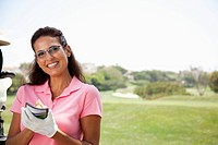 Woman keeping score during golf game