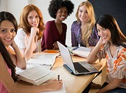 Businesswomen smiling in meeting