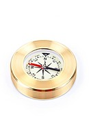 Gold compass on a white background