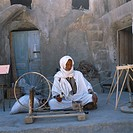 Medenine Tunisia Man Spinning Fibre With Old Bicycle Wheel