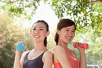 Chinese women lifting dumbbells