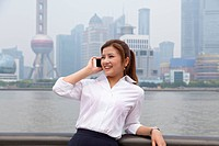 Business woman talking on smartphone