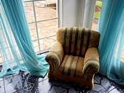 Small chair and blue drapes, Harare, Zimbabwe