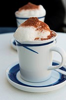 A Hot Beverage Served In A Cup And Saucer With Foam And Cinnamon, Zurich Switzerland