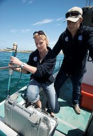 Shark scientists Oliver Jewell and Alison Towner deploy a directional hydrophone coupled to a VEMCO RM100 Ultrasonic telemetry receiving device which ...