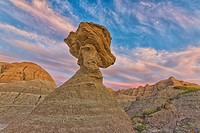 A large hoodoo balanced on a pedestal badlands national park, south dakota united states of america