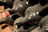 Dirty and dusty wine bottles in a cellar, la rioja spain