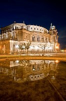 Semperoper at night with a reflection in water, Dresden, Germany