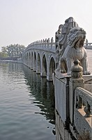 Decorative Balusters And Sculptures On A Bridge Crossing The Water, Beijing China