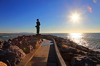 Italy,Tuscany,Livorno,San Vincenzo harbor, statue on the sea