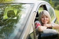 Middle_aged woman leaning out car window