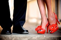 non-traditional bride & groom wearing orange wedding shoes @ their intimate winery wedding