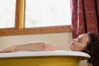 Middle_aged woman relaxing in bath tub