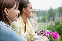 Mother and daughter relaxing together on outdoor porch