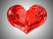 Wine or blood. Red liquid heart shape