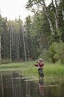 Middle_aged man casting his fly fishing rod