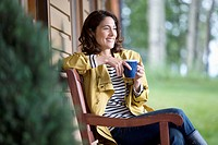 Pretty woman enjoying her coffee outdoors (thumbnail)