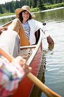 Mature couple enjoying a canoe ride together (thumbnail)