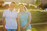 Two female golfers posing together