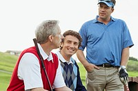 Golfers sitting on bench having a conversation