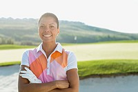 Portrait of pretty, African American female golfer