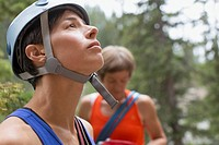 Female rock climber looking up at challenge